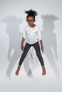 Portrait of Young African American girl jumping Royalty Free Stock Photo