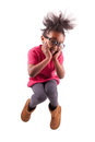 Portrait of Young African American girl jumping Royalty Free Stock Images