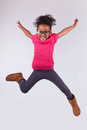 Portrait of Young African American girl jumping Stock Images