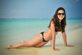 Portrait of young asian looking woman lie down in bikini at  tropical beach at Maldives Royalty Free Stock Photo
