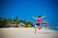 Portrait of young asian looking woman rising up hands at beautiful tropical beach at Maldives Royalty Free Stock Photo