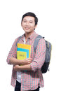 Portrait of young asian student holding books Royalty Free Stock Photo