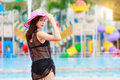 Portrait of a young Asian woman in bikini swimsuit and sun hat s Royalty Free Stock Photo