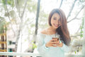 Portrait of a young asian woman drinking her morning tea. Fell r Royalty Free Stock Photo