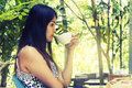 Portrait young asian woman drinking hot green tea latte in coffe Royalty Free Stock Photo