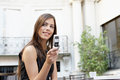 Portrait young attractive businesswoman using cell phone having coffe coffee shop s terrace outdoors Royalty Free Stock Photos