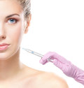 Portrait of a young and attractive naked blond caucasian woman on a botox injection procedure the is isolated on a white Royalty Free Stock Photos