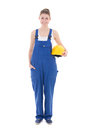 Portrait of young attractive woman builder in blue workwear iso isolated on white background Royalty Free Stock Image