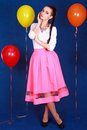 Portrait of a young attractive woman near many bright balloons Royalty Free Stock Photo
