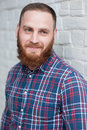 Portrait of a young bearded man in a flannel shirt Royalty Free Stock Photo