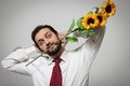 Portrait young bearded man sunflowers his mouth Stock Photo