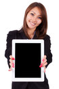 Portrait of a young beautiful asian business woman holding a ta tablet pc isolated on white background people Royalty Free Stock Image
