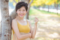 Portrait of young beautiful asian woman with short hairs style t toothy smiling face happiness emotion standing in blooming Royalty Free Stock Photography