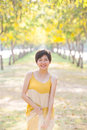 Portrait of young beautiful asian woman wearing yellow long dres Royalty Free Stock Photo
