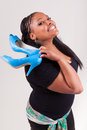 Portrait of a young beautiful black woman holding a pair of shoes Stock Photography