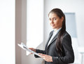 Portrait of young beautiful business woman with documents Royalty Free Stock Photo