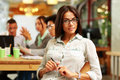 Portrait of a young beautiful businesswoman in office with her colleagues in background Royalty Free Stock Photography