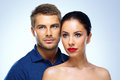 Portrait of a young beautiful couple on blue background Royalty Free Stock Photo