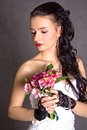 Portrait of a young beautiful fiancee with a bunch of pink flowe Royalty Free Stock Photo