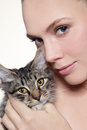 Portrait young beautiful fresh girl holding kitten her hands Royalty Free Stock Photo