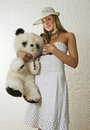 Portrait of a young beautiful gir girl woman with teddy bear Stock Photography