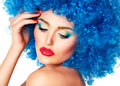 Portrait of a young beautiful girl with bright makeup in blue wi red lips wig Royalty Free Stock Image