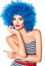 Portrait of a young beautiful girl with bright makeup in blue wi red lips wig Royalty Free Stock Photography