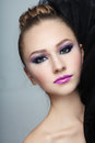 Portrait young beautiful girl fancy make up hair bun Stock Photography