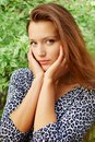Portrait young beautiful redhead woman garden Stock Photo