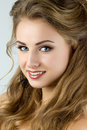 Portrait of young beautiful smiling woman with black earrings Royalty Free Stock Image