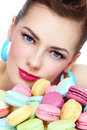 Portrait of young beautiful woman with colorful macaroons Royalty Free Stock Photography