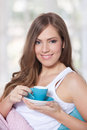 Portrait of a young beautiful woman drinking a cup of coffee Stock Images