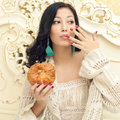 Portrait of young beautiful woman eating her croissant Royalty Free Stock Photo