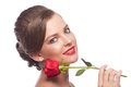 Portrait of young beautiful woman with makeup holding red rose isolated on white background Royalty Free Stock Photos