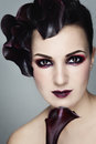 Portrait young beautiful woman stylish fancy retro make up violet flowers her hair white background Royalty Free Stock Photography