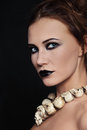 Portrait young beautiful woman stylish make up skull necklace Royalty Free Stock Image