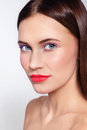 Portrait of young beautiful woman with stylish white eyeliner and coral matte lipstick Royalty Free Stock Images