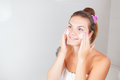 Portrait of young beautiful woman using cosmetics cream on her face color toned image cosmetic beauty concept Royalty Free Stock Photos