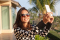 Portrait of young beautiful woman wearing sun glasses take a pho photo selfie by mobile phone use for modern digital life and Royalty Free Stock Images