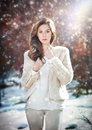 Portrait of young beautiful woman wearing white clothes outdoor beautiful brunette girl with long hair posing outdoor in winter a Royalty Free Stock Photography