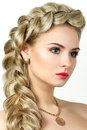Portrait of young blonde woman with fishtail hair dress Royalty Free Stock Image