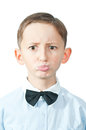 Portrait of young boy emotional discontent over white background Royalty Free Stock Photos