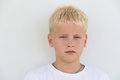 Portrait of a young boy with focused look in white t shirt Royalty Free Stock Photography