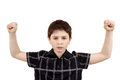 Portrait of a young boy with hand raised up against white background Royalty Free Stock Image