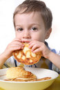 Portrait of a young boy having breakfast Royalty Free Stock Photos