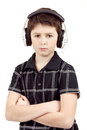 Portrait of a young boy listening to music on head headphones against white background Royalty Free Stock Photos