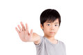 Portrait of a young boy making stop gesture