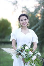 Portrait young bride with brunette hair in white wedding dress a