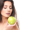 Portrait of a young brunette holding an apple Royalty Free Stock Image