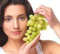 Portrait of a young brunette holding fresh grapes Stock Photo